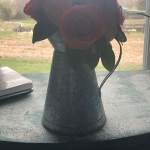Metal pitcher and faux flowers